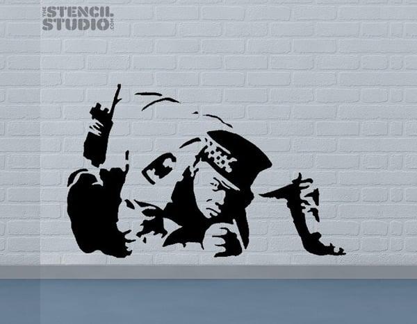banksy style coke cop stencil