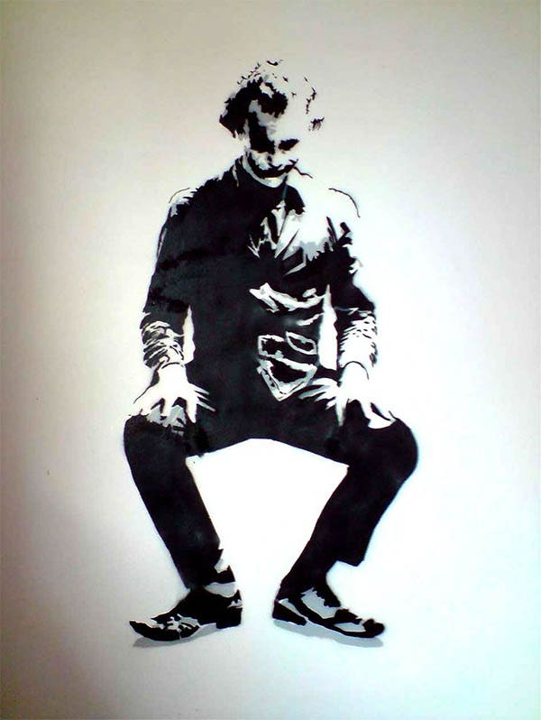 joker stencil by docik on wall