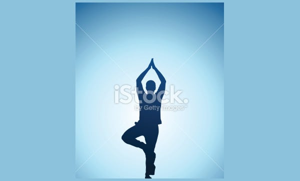 man performing yoga in front of a sunset