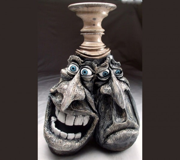 ceramic sculpture artworks happy sad face
