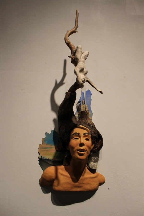 ceramic sculpture artworks woman tied child