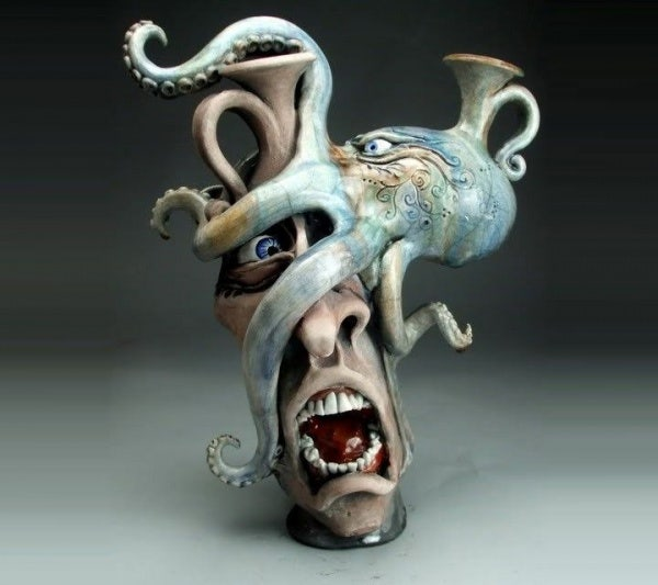 ceramic sculpture artworks octpus hold man face