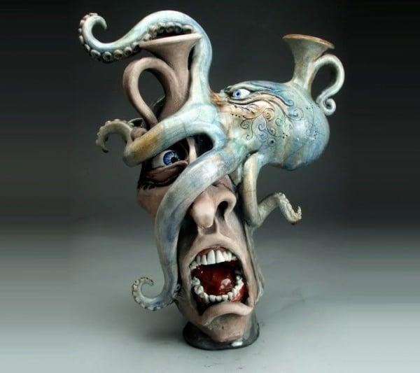 ceramic sculpture artworks octpus hold man face