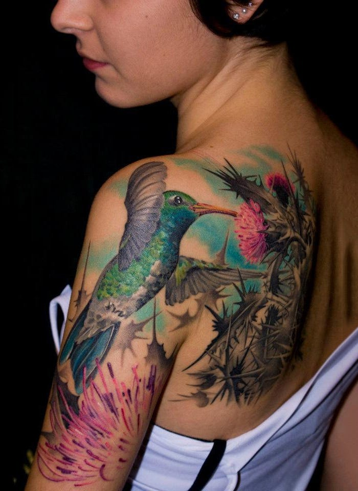 bird tattoo woman