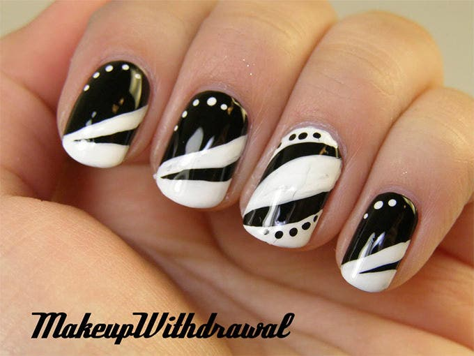 black and white nail tip design