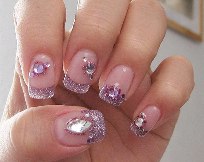 30 glitter nail designs and creative ideas free premium templates beautiful faint pink bodies with a thick border of shining silver the nail art design comprises of a crystal bead on each nail where the nail body meets prinsesfo Gallery
