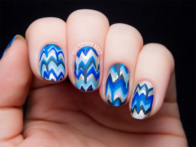 This blue nail art design image has various shades of blue, black and white  in zigzag pattern. You can draw it yourself with a sharp brush and gel nail  ... - 25+ Blue Nail Art Designs & Ideas Free & Premium Templates