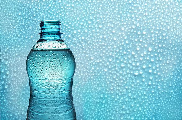 aqua bottle on water drops background
