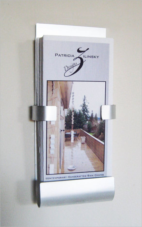this wall mounted metal brochure saves a lot of space for your office desk the metal structure is classy and the little holding arms in the middle and the