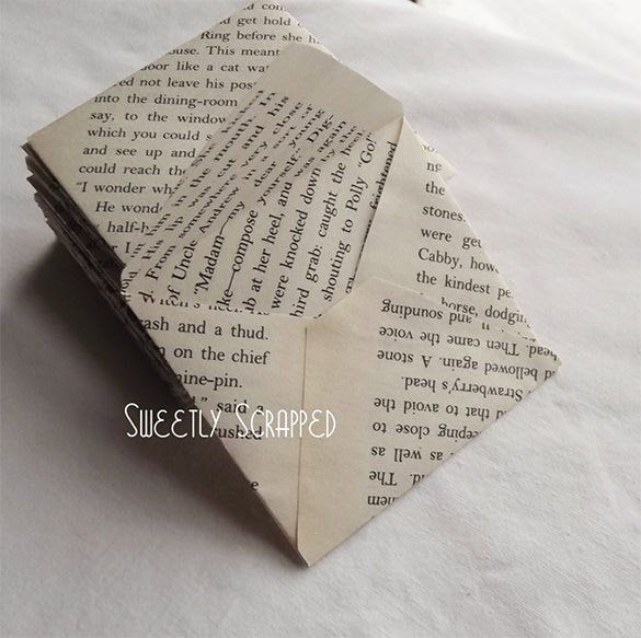 mini envelopes 3 x 3 created out of book or newspaper pges