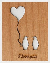 penguins anniversary card on wood