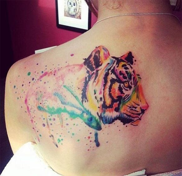 facinating tiger on her back tattoo