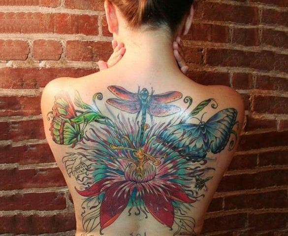 dragonflies tattoo on her back