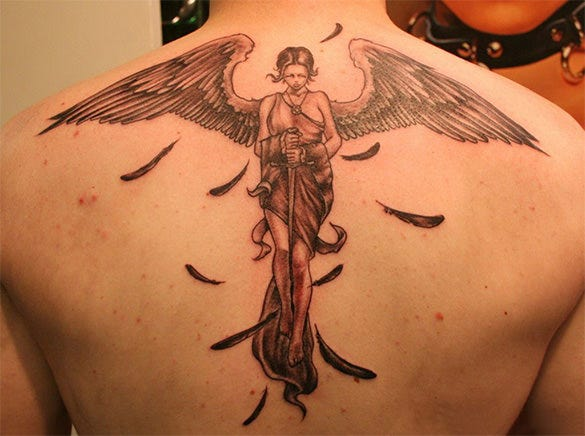 angel tattoo on spine