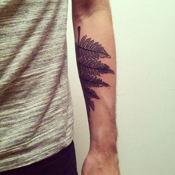 leaf art tattoo on hand