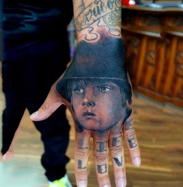 ferocious tattoo on hand