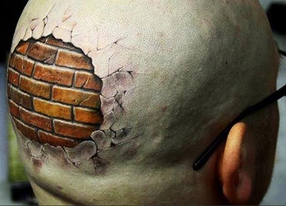 head against a brick wall tattoo