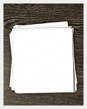 White-blank-paper-on-wooden-table
