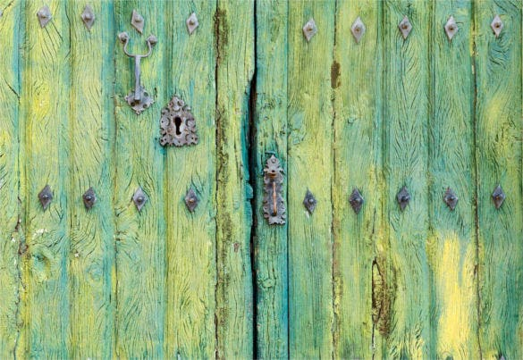 old wooden rustic green door background