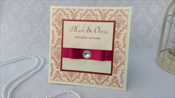 handmade wedding invitation with damask pattern and satin ribbon