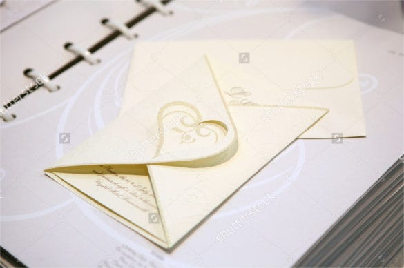 handmade paper wedding invitation with heart shape