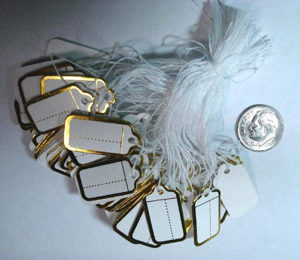 gold foiled paper price tags with string