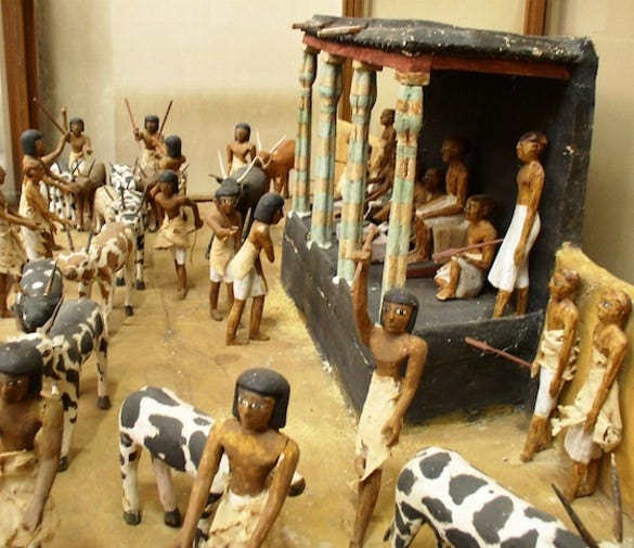 model of the deceased overseeing the counting of cattle