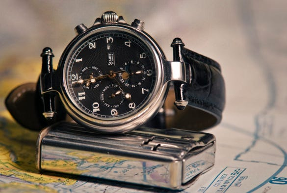 still life photography of black automatic wristwatch