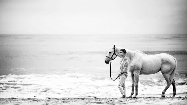 Black & White Horse Girl on Beach Background Download