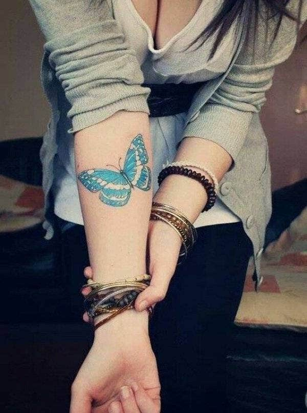 arm butterfly tattoo on girl