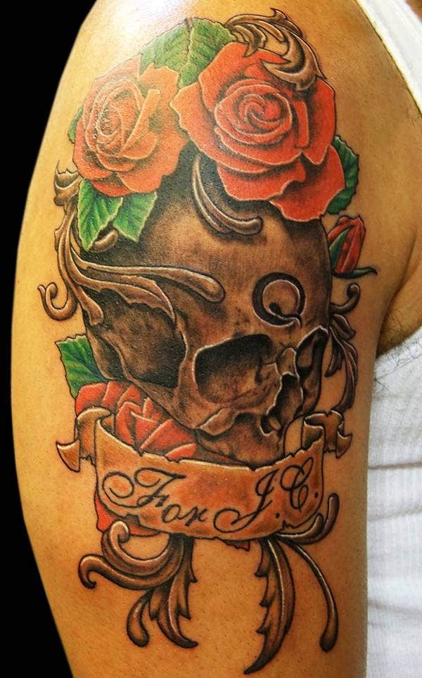 skull and roses arm tattoo