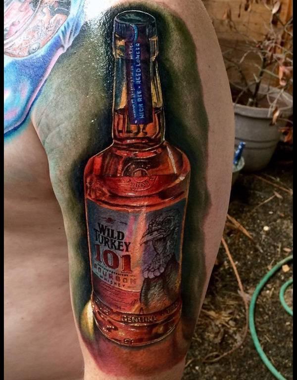 wild turkey bottle tattoo on arm
