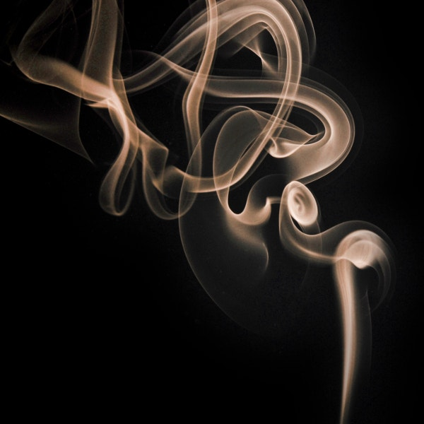 a mere curl of smoke
