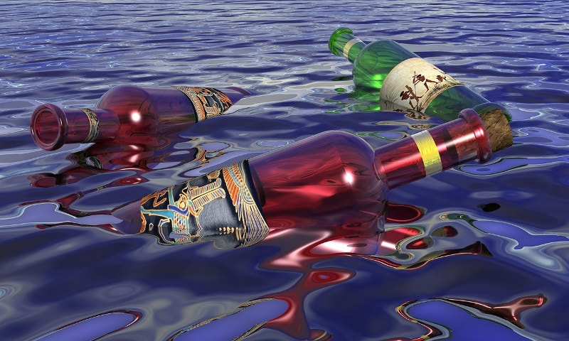 Empty Bottles Floating on Water
