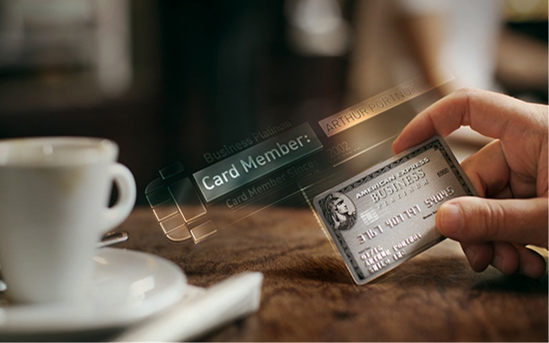 Designed Credit Card Placed Near Cup
