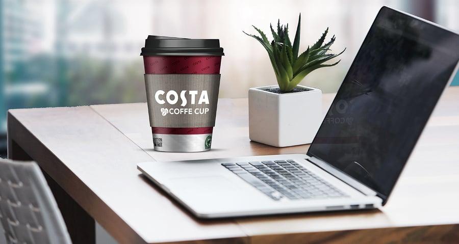 coffee cup mockup near laptop
