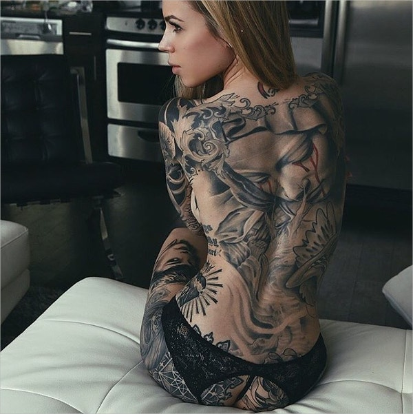 woman with full of tattoo designs