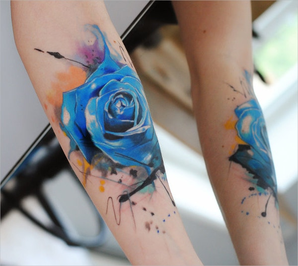 blue watercolor rose tattoo