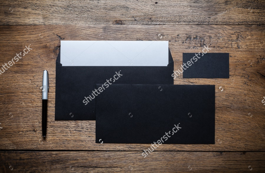 set-of-black-branding-envelopes-on-vintage-wood