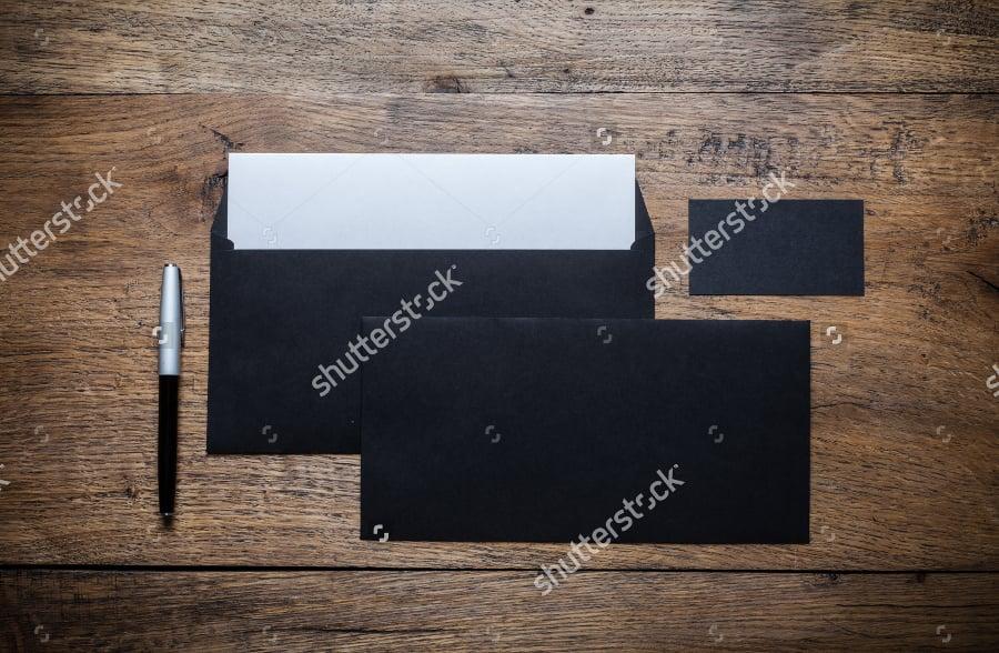 set of black branding envelopes on vintage wood
