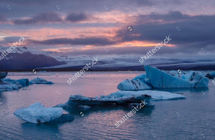 icebergs floating at sunset