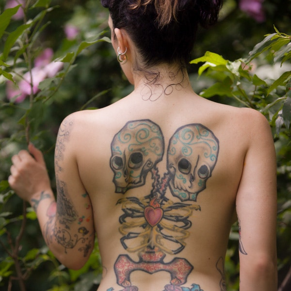 girl with skull design tattoo
