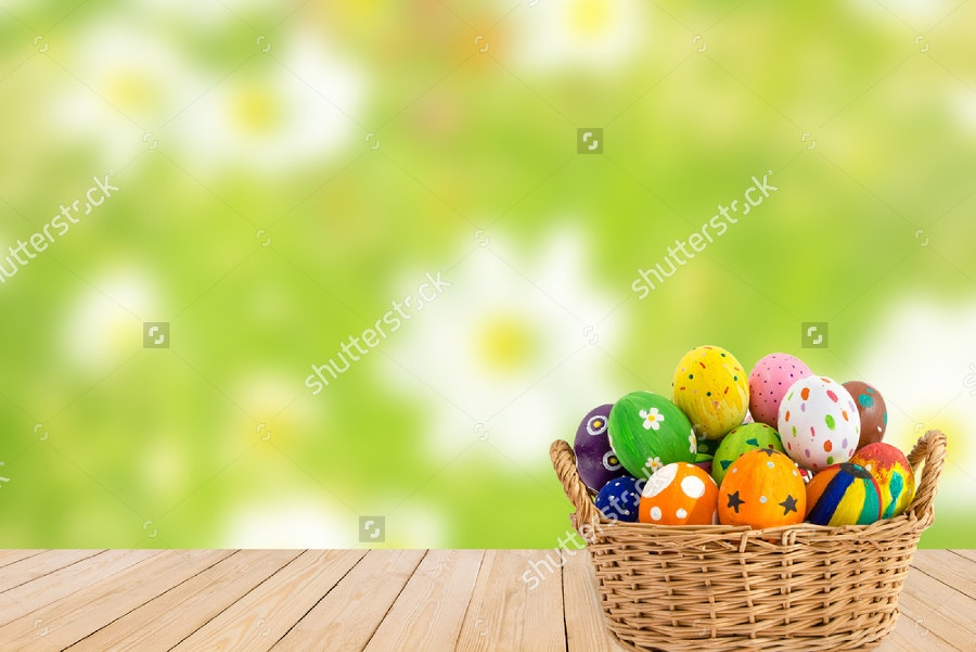 Colorful Easter Eggs on Green Background