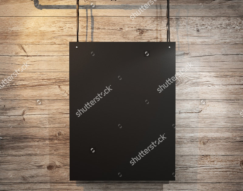 Black Poster Hanging on Wood Background