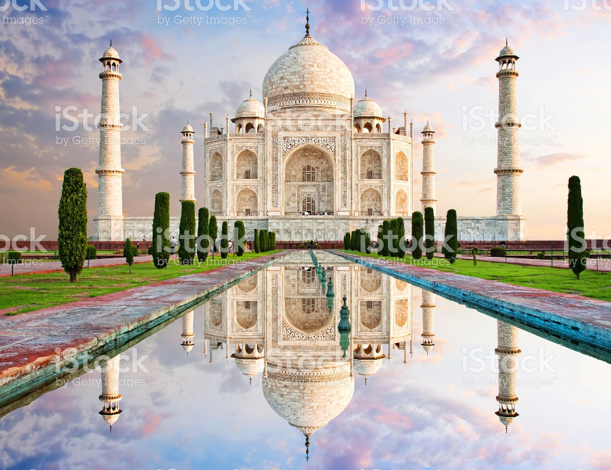 taj mahal reflection in sunset