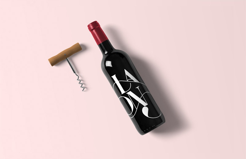 Wine Bottle Mockup on Pink Background