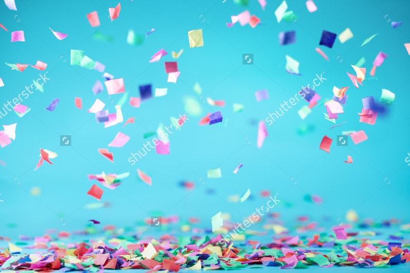 confetti flying on blue background