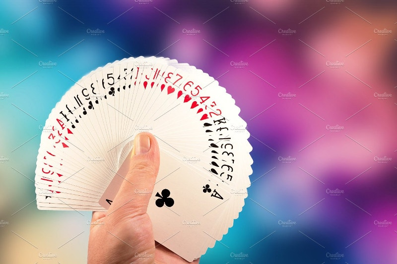 Playing Cards in Magician Hand