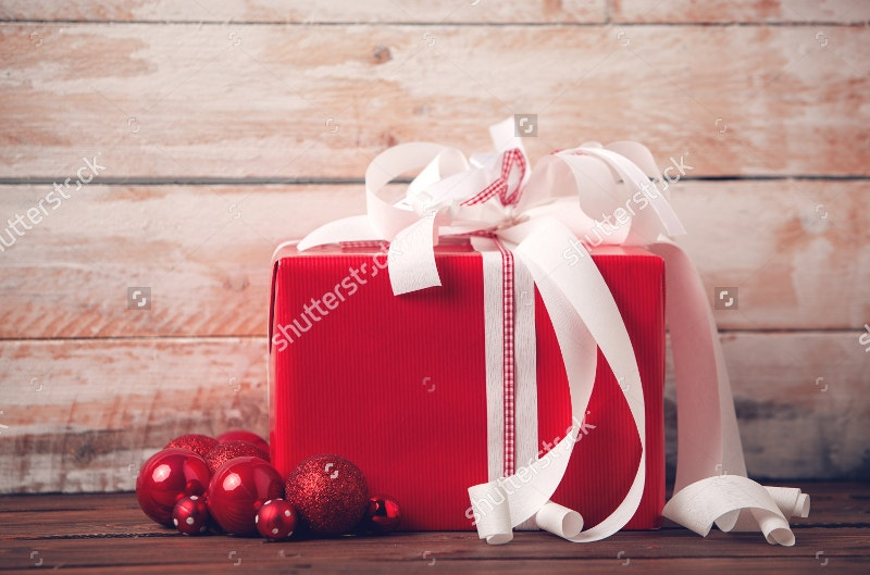 christmas packaging on wooden background