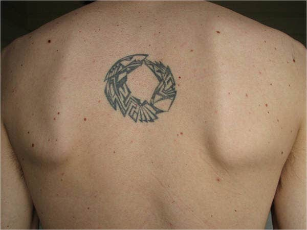 Small Decorative Tattoo on Back